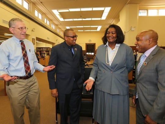 Gary Newman, senior librarian; Oscar Davis Jr., president