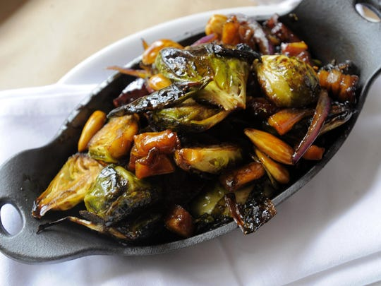 The Red Crown takes a farm-to-table approach for southern-style menu items like these Brussels Sprouts sautéed with almonds.