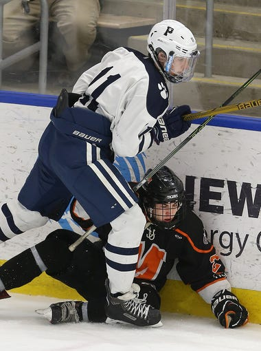 Pittsford's Quinn Doyle checks Mamaronek's Chris Conley against the boards.