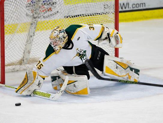 St. Norbert College goalie Tony Kujava (35) has a 1.81