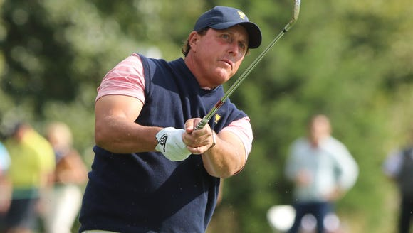 Phil Mickelson hits from the 13th fairway.
