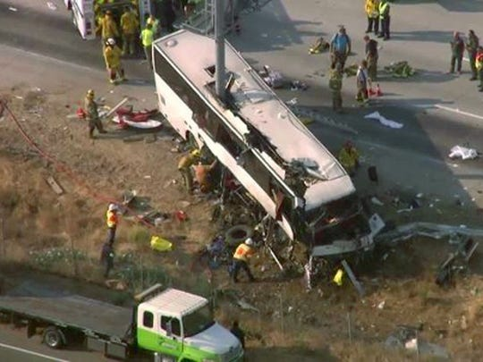 This still frame from video provided by KCRA3-TV shows authorities investigating the scene of a charter bus crash on northbound Highway 99 between Atwater and Livingston, Calif., Tuesday, Aug. 2, 2016.