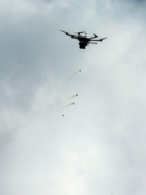 A picture taken on March 30, 2018 shows an Israeli military drone flying after dropping tear gas grenades during clashes with Palestinian protesters following a demonstration commemorating Land Day, near the border with Israel, east of Gaza City.