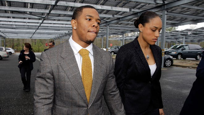 Baltimore Ravens football player Ray Rice holds hands with his wife, Janay Palmer, as they arrive at Atlantic County Criminal Courthouse in Mays Landing, N.J.