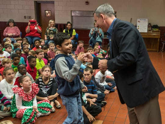 Third-grader Jose Vasquez is congratulated by Autauga County School Superintendent Spence Agee in 2015.