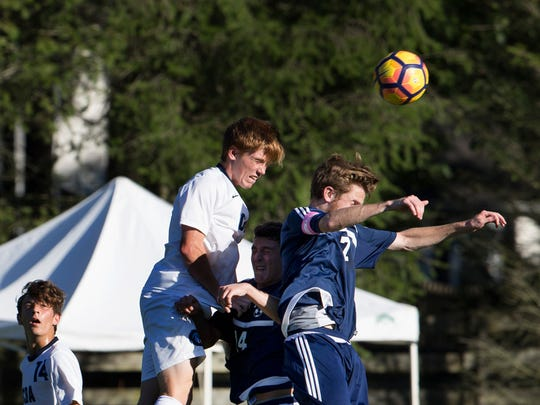CBA's Jhn Askin and Howell's Brandon Downey battle for a corner kick during first half action.