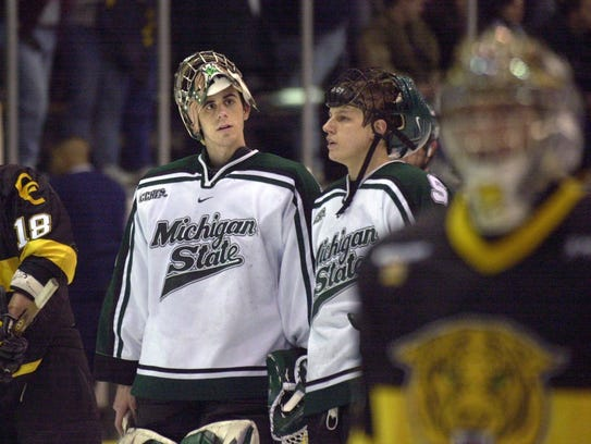 MSU goalie Ryan Miller, left, and forward Steve Jackson,