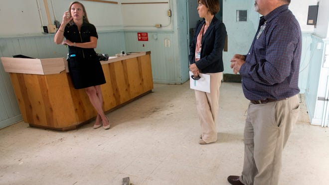 Escambia Community Clinics Executive Director, Chandra Smiley, left, Chief community Engagement Officer, Ann Papadelias, center, and Facilities Manager, Luis Real, right, are working on a plan to move the majority of the organization's services to the former Ynestria Elementary School on West Jackson Street. The community health organization bought the old school building in late March and is planning to begin operations in the new building in the fall of 2017.