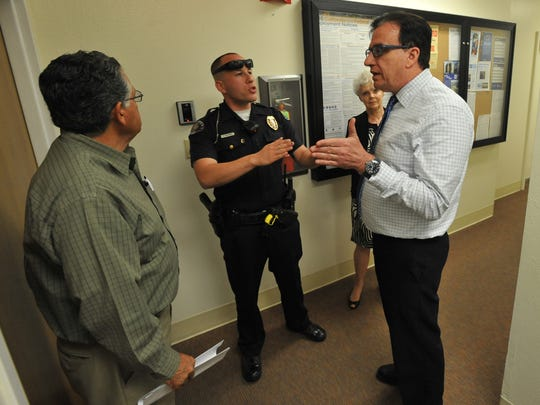 Alberto Aguilar and Benny Benzeevi, CEO of HealthCare Conglomerate Associates, discuss a solution to a standing room only problem before the Tulare Regional Medical Center board of directors meeting in the Allied Services building on Wednesday, April 27, 2016.
