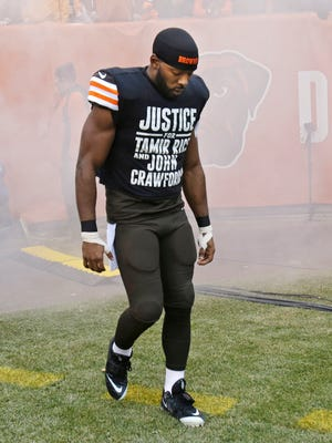 Cleveland Browns wide receiver Andrew Hawkins wears a shirt calling attention to the police shootings of Tamir Rice and John Crawford before an NFL football game against the Cincinnati Bengals on Sunday.