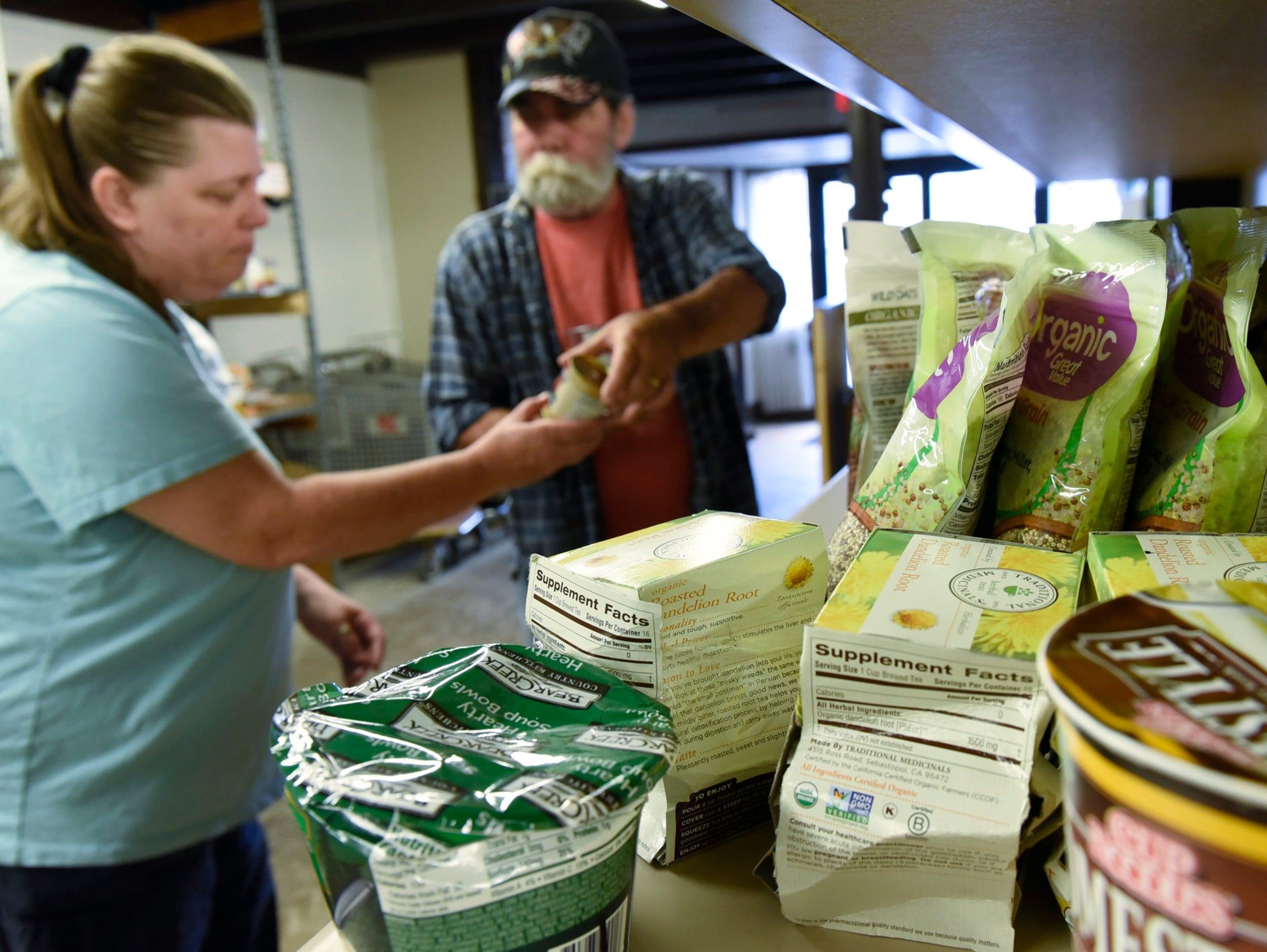 Bob and Susan Hazard shop for groceries Thursday, June
