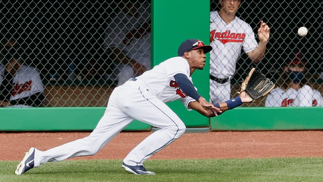 Cleveland Indians' Greg Allen makes a diving catch during the seventh inning of a baseball game, Sunday, Aug. 23, 2020, in Cleveland. (AP Photo/Ron Schwane)