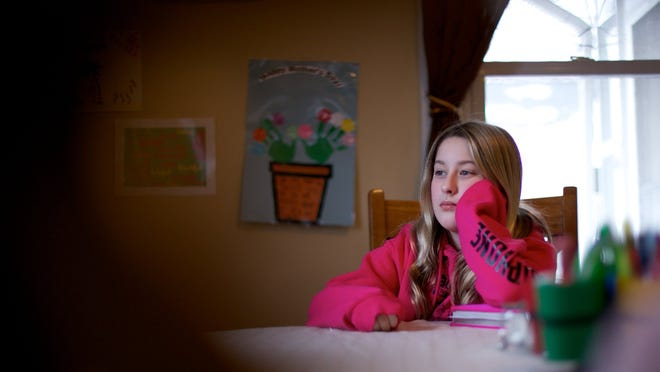 Elliot Corbin, 12, in her home in Mt. Clemens. Some parents who've grown concerned about the amount of testing are opting their kids out this year, including Elliot's mother, Deborah Corbin. Elliot and her sister both say the tests brought them stress and anxiety.