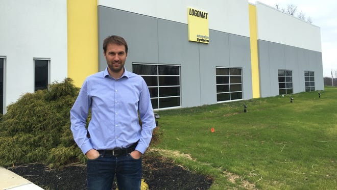 Philipp Krups, president and CEO of Logomat, stands outside the company's Hebron facility.