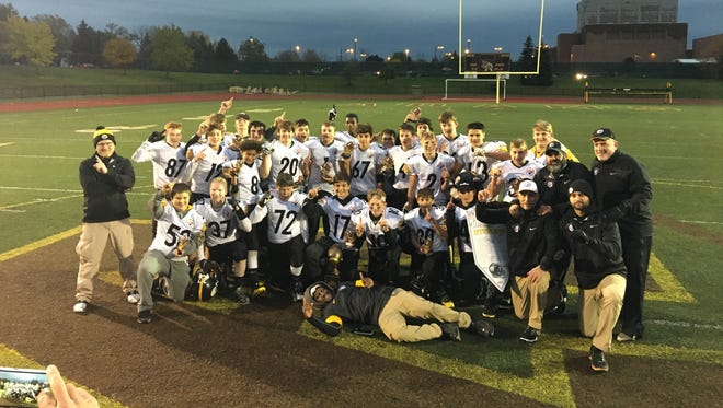 The Plymouth Canton Steelers celebrate after winning the recent Super Bowl.