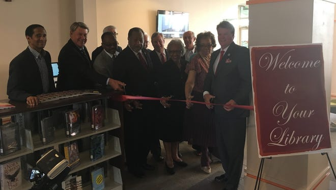 City and county leaders gather to cut the ribbon for the reopening of the Juliette Morgan Memorial Library on Monday, April 23, 2018 in Montgomery, Ala.