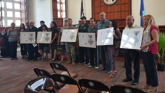 Six Chamoru Vietnam War veterans, some represented by family and friends, were given legislative resolutions in honor of their heroic actions during the war and for receiving the Distinguished Service Cross Award on June 11, 2018.