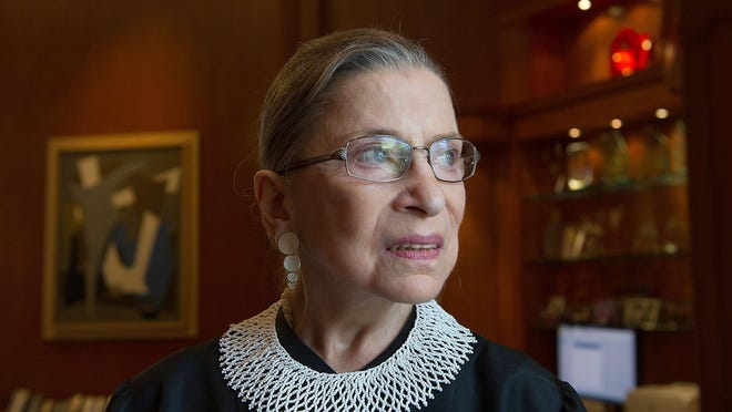 Supreme Court Associate Justice Ruth Bader Ginsburg poses in her chambers in 2013.