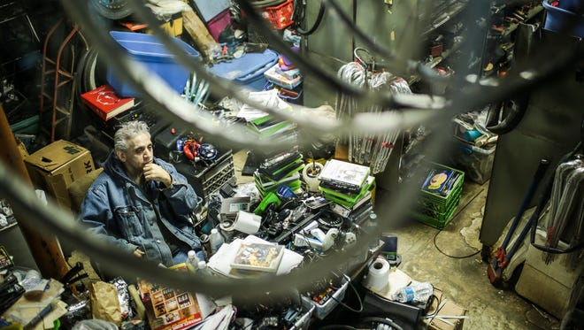 Sam Awada, 56, of Dearborn, the owner of Livernois Bike Shop, sits by his desk on Tuesday, March 22, 2016, in Detroit.