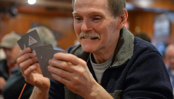 Steve Wolfe checks his hand of cards during the 42nd Annual Peg 'n Keg cribbage tournament Saturday, April 30, at the La Playette in St. Joseph. The tournament was started in a St. John's University dorm in the 1970's. Wolfe started playing with the group in 1978.