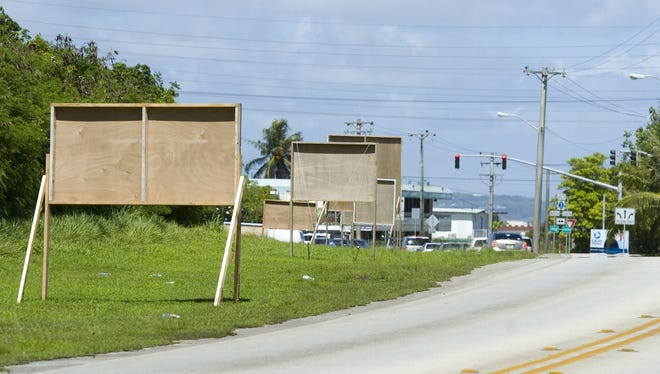 In this July 2010 file photo, election signs crowd the roadside near the Route 1 and Route 27A intersection in Dededo.
