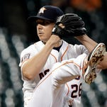 Houston Astros' Scott Kazmir winds up for a pitch against the Seattle Mariners during the first inning of a baseball game Wednesday, Sept. 2, 2015, in Houston.