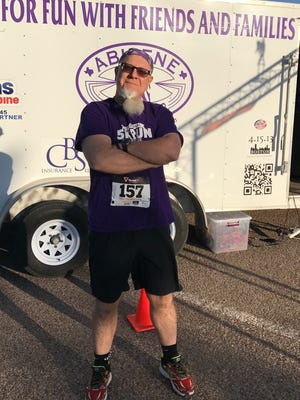 Newspaper columnist Greg Jakewicz is ready to race and looks fresh before the Rescue the Animals, SPCA 5K on Saturday morning at Nelson Park.