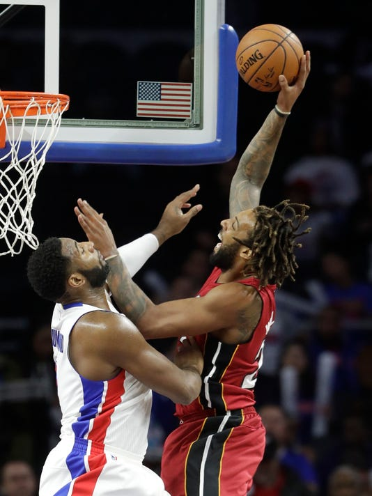 Miami Heat forward Derrick Williams, right, shoots over Detroit Pistons center Andre Drummond (0) during the first half of an NBA basketball game, Wednesday, Nov. 23, 2016 in Auburn Hills, Mich. (AP Photo/Carlos Osorio)
