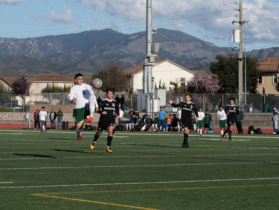 Junior forward Angel Amezcua (6) elevates to shoot