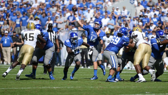 UK QB Patrick Towles passes during the first half of the University of Kentucky Football game against the Vanderbilt Commodores in Lexington, KY. Saturday, September 27, 2014.
