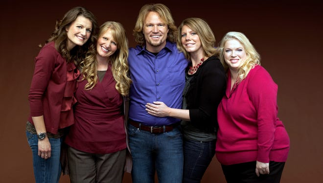 "Kody Brown, center, poses with his wives, from left,  Robyn, Christine, Meri and Janelle, in a promotional photo for the reality series, ""Sister Wives,"" which aired in March 2011 on TLC."