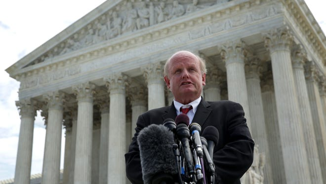 Susan B. Anthony List's lawyer, Michael Carvin, speaks outside the Supreme Court on Tuesday.