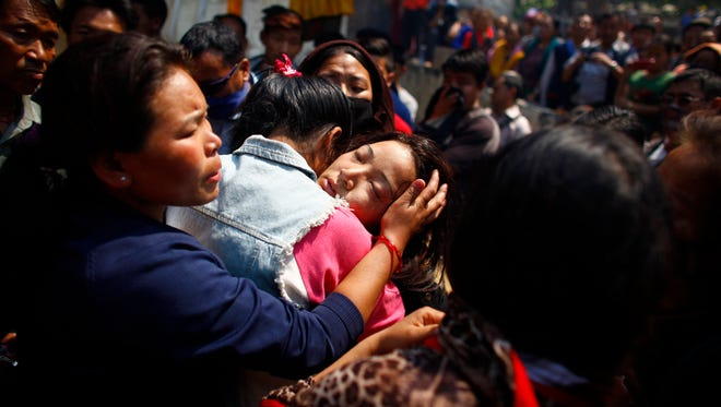 Daughter of Nepalese mountaineer Ang Kaji Sherpa, killed in an avalanche on Mount Everest, cries during the funeral ceremony in Katmandu, Nepal, on Monday.