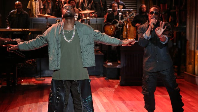 """Kanye West, left, performs for """"Late Night with Jimmy Fallon."""""""