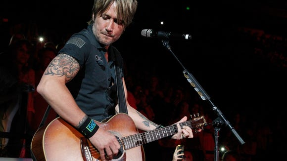 Keith Urban performs at a benefit concert in Nashville earlier this year.