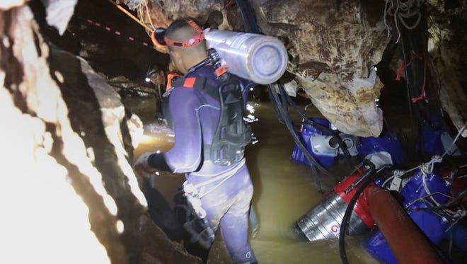 Uundated handout photo taken recently and released by the Royal Thai Navy on Saturday shows a group of Thai Navy divers in Tham Long cave during rescue operations for the 12 boys and their football team coach trapped in the cave at Khun Nam Nang Non Forest Park in the Mae Sai district of Chiang Rai province.