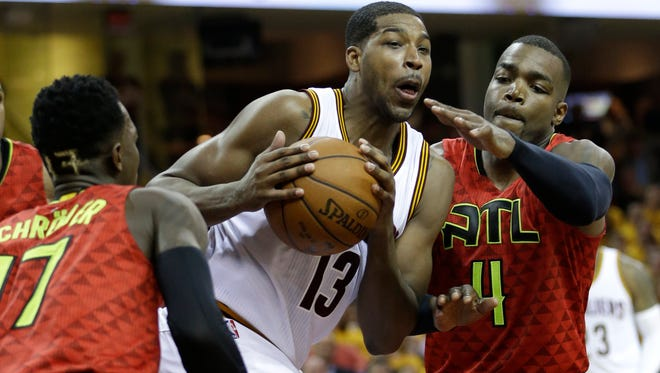 Cleveland Cavaliers' Tristan Thompson (13) drives on Atlanta Hawks' Paul Millsap (4) in Game 1 of their Eastern Conference semifinals series.