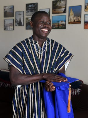 George Mwinnyaa of Ghana, West Africa poses for a photograph at his home on May 19, 2015. Mwinnyaa is graduating from TMCC on Friday.