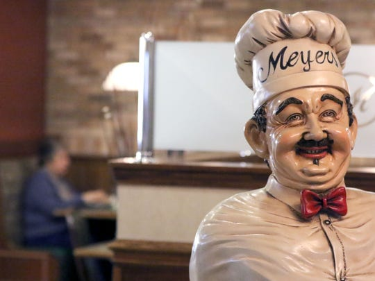 A chef statue greets diners as they enter Meyer's Restaurant