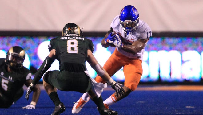 Boise State running back Jeremy McNichols puts a move on CSU safety Jake Schlager during last Saturday night's game in Boise, Idaho. Only two teams in the country rank below CSU in third-down defense.