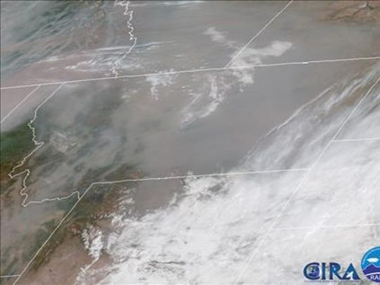 This satellite image shows widespread smoke over most of Montana Sunday.