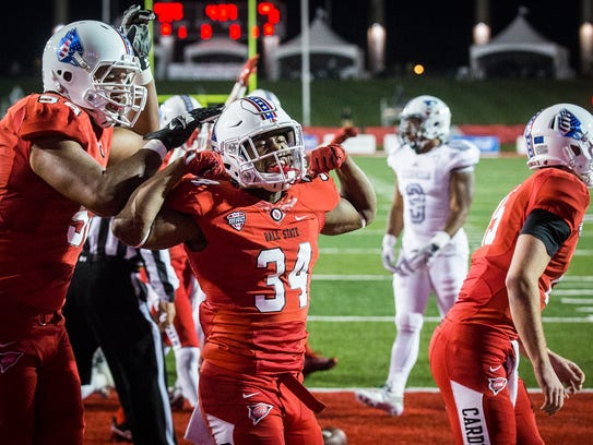 Ball State's James Gilbert celebrates a touchdown against