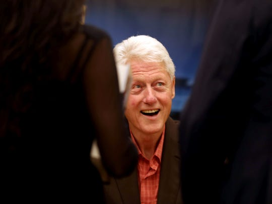 Former President Bill Clinton greets some  of the five
