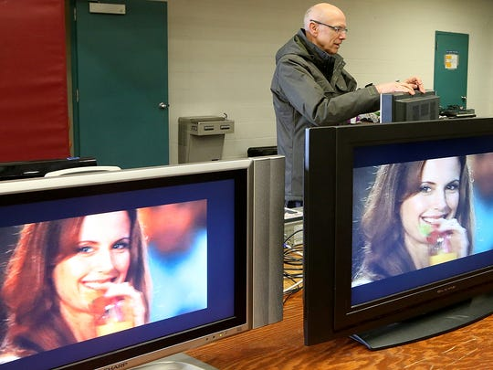 East Bremerton Rotarian Bill Benson setups the TV section for the Kitsap Rotary Auction and Garage Sale, which supports the good works of Rotary clubs in Silverdale, Bremerton, East Bremerton and South Kitsap, at the Kitsap Sun Pavilion on Thursday.