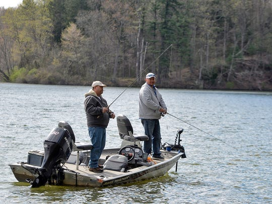Toua Moua, left of Leola, and brother Chia Moua, of Columbia, fish from their bass boat on Lake Williams, Sunday, April 29, 2018. John A. Pavoncello photo