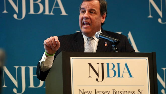 """New Jersey Gov. Chris Christie addresses a gathering of New Jersey business leaders Tuesday, Dec. 8, 2015, in East Windsor, N.J. As keynote speaker at the New Jersey Business & Industry Association event, Christie unleashed blistering criticism against New Jersey business leaders for not financially supporting Republicans in state elections and said the consequence is Democratic majorities and proposals for higher taxes. Christie said he attended the event to lay down a challenge to the business executives in attendance, saying they cannot continue to """"play kissy face"""" with Democrats. (AP Photo/Mel Evans)"""