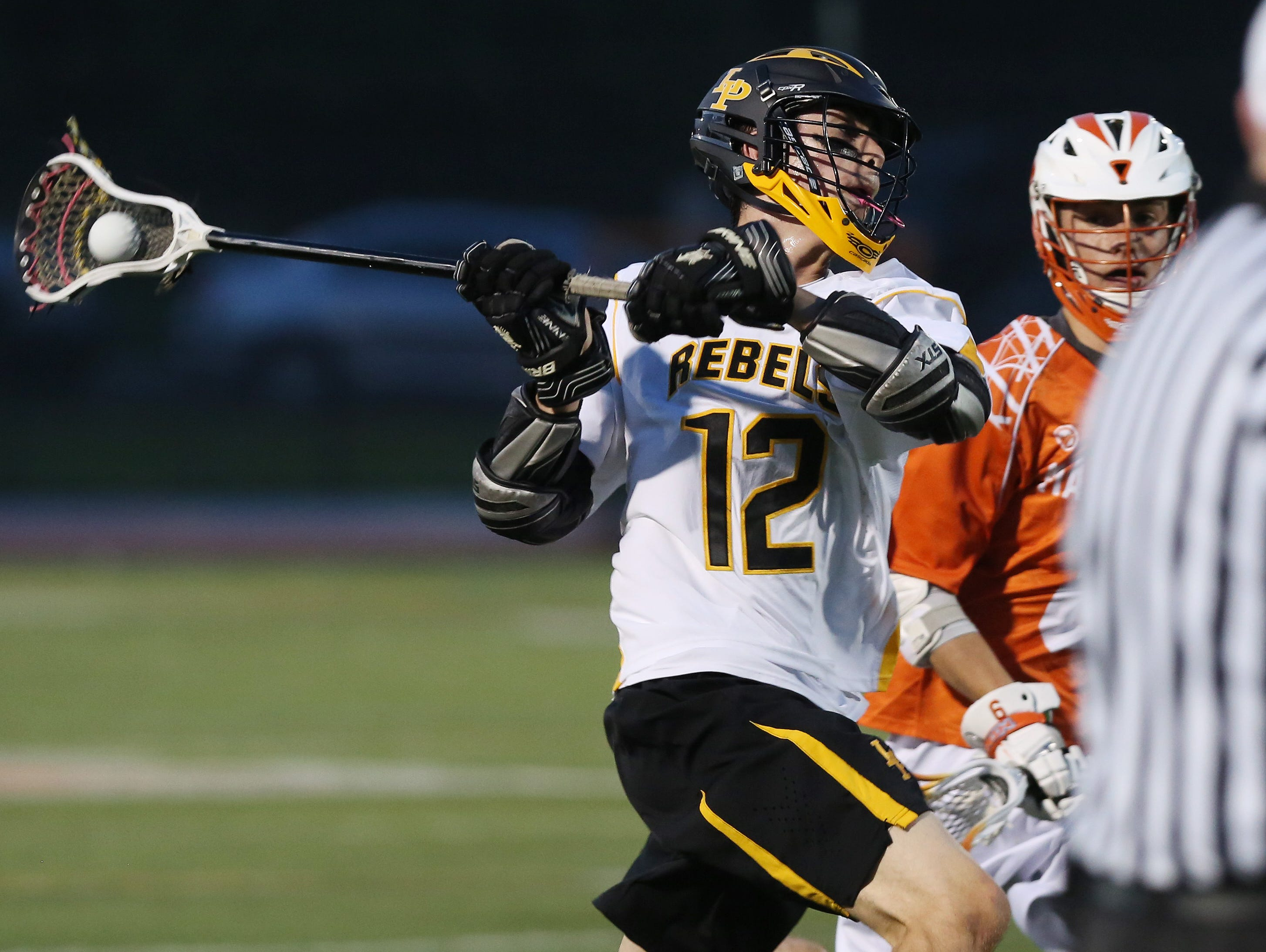 Lakeland/Panas' Drew Thompson (12) fires a shot against Mamaroneck for a first half goal during the Section 1 championship game at White Plains High School May 25, 2016.