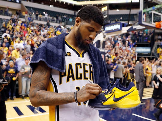 Indiana Pacers forward Paul George (13) autographs