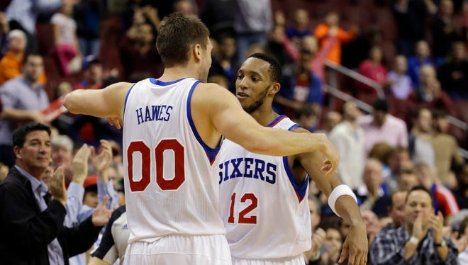 Philadelphia 76ers' Evan Turner (12) and Spencer Hawes (00) were traded at the NBA trade deadline.
