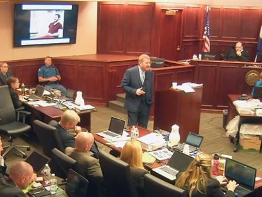 In this image taken from video, accused Colorado theater shooter James Holmes, on the upper far left, listens to defense attorney Daniel King give closing arguments during his trial, in Centennial, Colo., Tuesday, July 14, 2015.